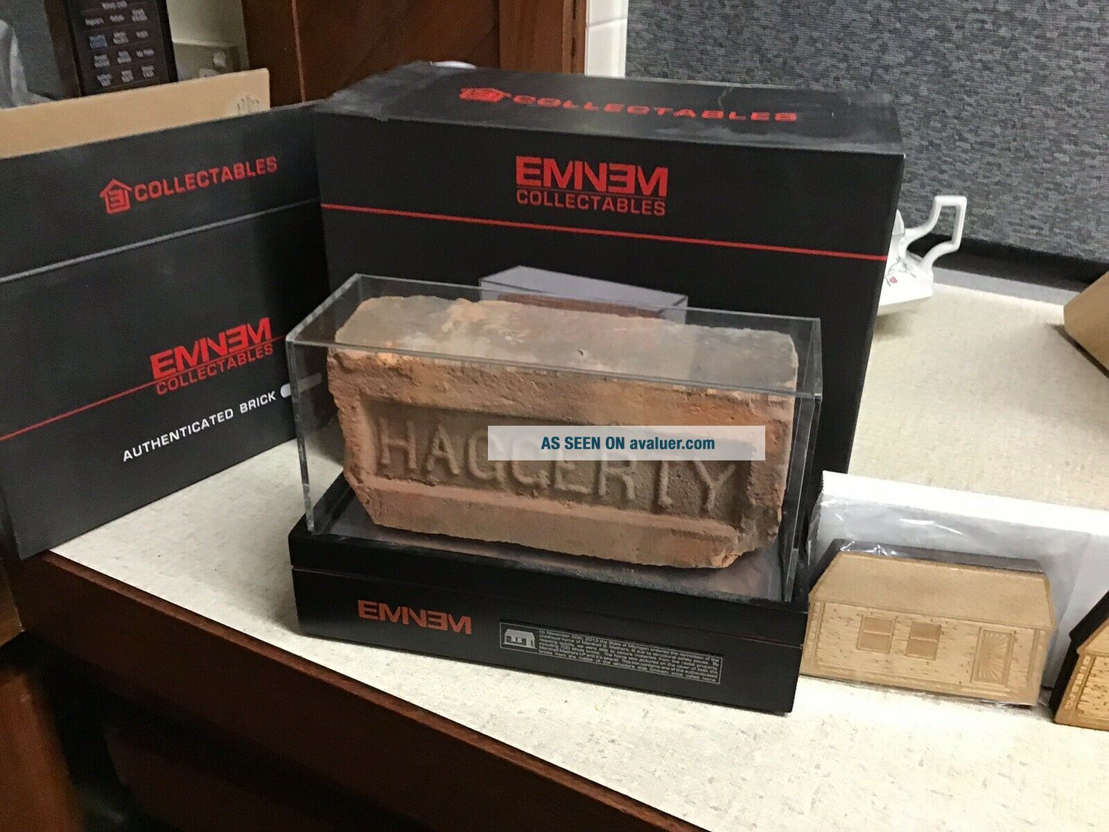 Eminem Signed Authenticated Brick And Dog Tag From Slim Shady's Childhood Home.